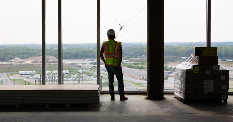 Student Brendan Daly looks out over the construction on UD's STAR campus.