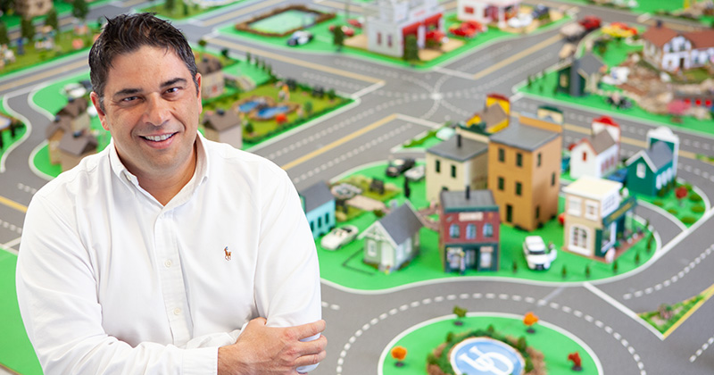 Andreas Malikopoulos is pictured in front of the University of Delaware's Scaled Smart City (UDSSC) testbed.