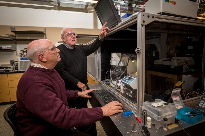 D. Bruce Chase, left, a research professor in the Department of Materials Science and Engineering, and John Rabolt, the Karl. W. and Renate Böer Professor of Materials Science and Engineering, are pictured in UD's Advanced Materials Characterization Lab.