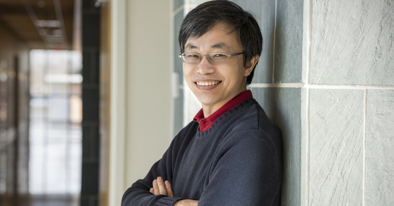 Yushan Yan is pictured in a hallway of the ISE lab at the University of Delaware.
