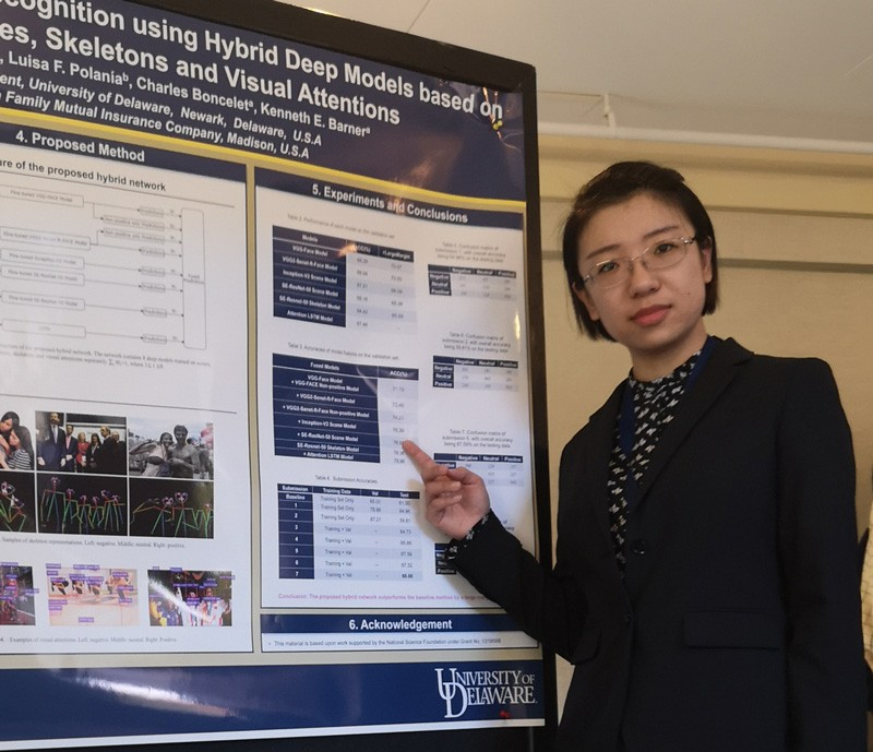 Cindy Guo is pictured with her research poster at EmotiW 2018.