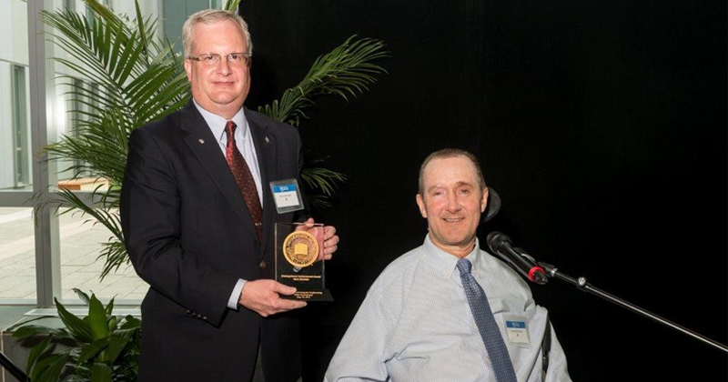 Mark Bendett is pictured with Ken Barner, Charles Black Evans Professor and chair of the Department of Electrical and Computer Engineering.