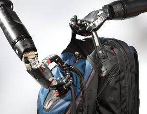 Robot hands zipping backpack