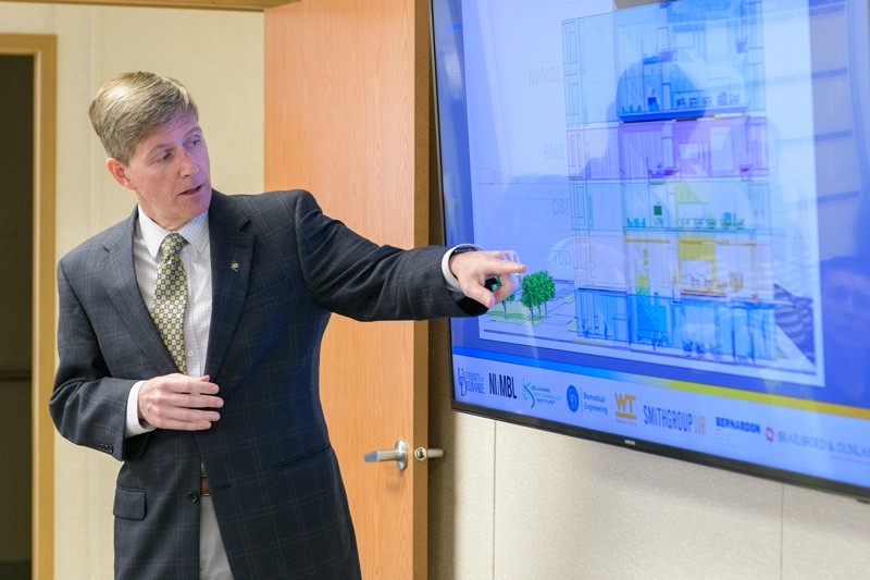 Charles G. Riordan, vice president for research, scholarship and innovation at UD, describes the plans for the Carol Ammon and Marie Pinizzotto M.D. Biopharmaceutical Innovation Center, which is under construction on UD's Science, Technology and Advanced Research (STAR) Campus. Delaware Gov. John Carney visited the site on Tuesday, Feb. 5.