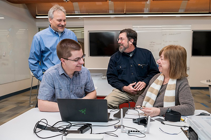 Device design is an iterative process that takes collaboration, communication and even some humor. Pictured from left to right: Prof. Richard Martin, UD junior Theodore Fleck, Prof. Scott Jones and Ingrid Predtzer-Aboff, senior nurse scientist at Virginia Commonwealth University.