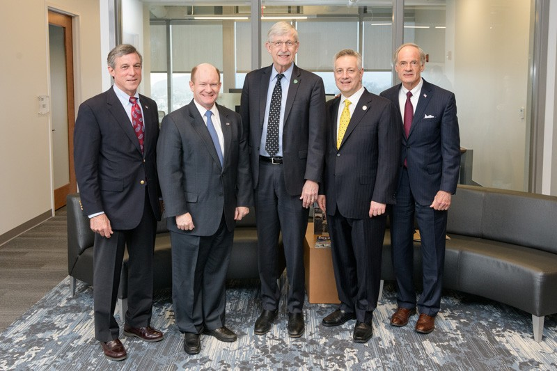 At the start of his first visit to the University of Delaware, Dr. Francis Collins (center), director of the National Institutes of Health, had a breakfast meeting with some of Delaware's top leaders, including (from left): Gov. John Carney, U.S. Sen. Chris Coons, UD President Dennis Assanis and U.S. Sen. Tom Carper.