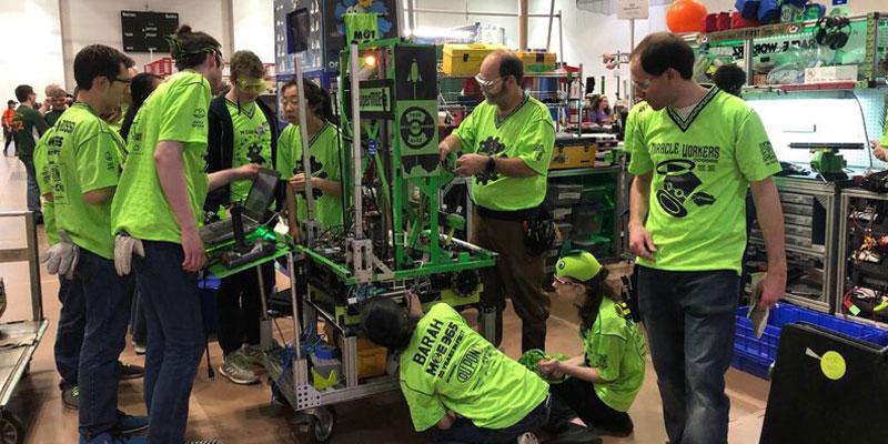 participants work on a robot