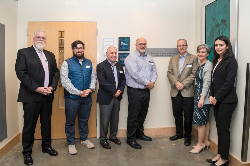 Representatives from Gore, Rigaku and UD pause before touring the Advanced Materials Characterization Laboratory. Pictured from the left: Tom McNulty (Rigaku), Gore representatives John Delluca (a UD alumnus), Michael Dougherty, Jeffrey Ledford, Greg Hannon, Amy Calhoun, and UD doctoral student Angela Cuadros.