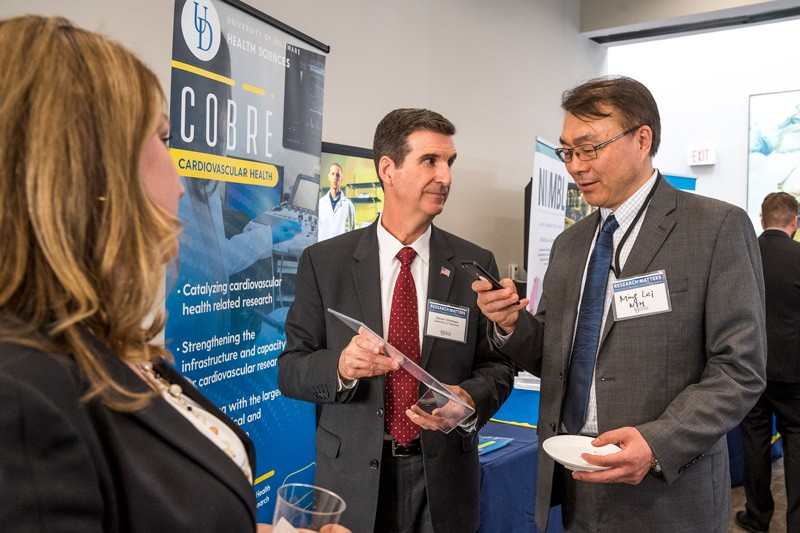 """UD Day in DC"" attracted leaders from federal agencies that support UD research. Here, Steven Stanhope (center), associate vice president for research at UD and director of Delaware INBRE, talks with Ming Lei of the National Institutes of Health."