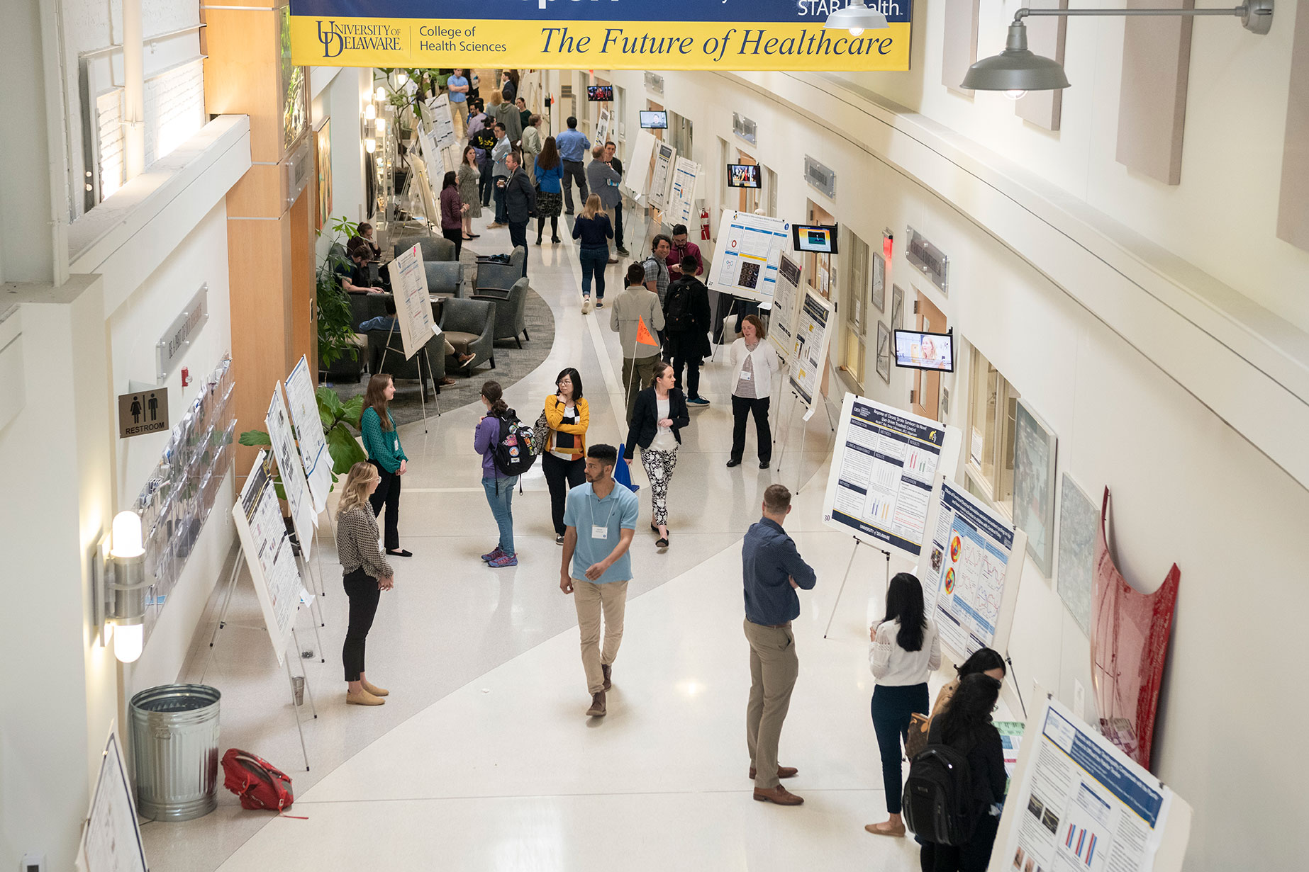 Students present posters.