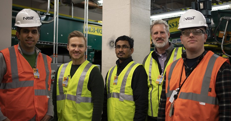 The research team is pictured at at Ted Stevens International Airport in Anchorage. The column in the background is retrofitted with a fiber-reinforced polymer composite. From left to right: Siamak Sattar, research structural engineer, Earthquake Engineering Group, National Institute of Standards and Technology (NIST); Jovan Tatar, assistant professor, Department of Civil and Environmental Engineering at the University of Delaware; Shafique Ahmed, doctoral candidate, Department of Civil and Environmental Engineering at UD; Jeff Robertson, director of engineering, QuakeWrap, Inc; David Goodwin, research chemist, Polymeric Materials Group, Engineering Laboratory, National Institute of Standards and Technology (NIST).