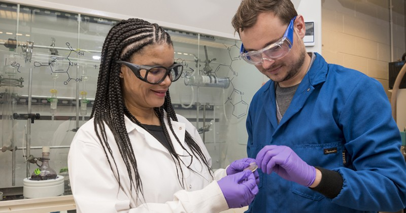 LaShanda Korley (left) and Chase Thompson examine a sample of the material they studied.