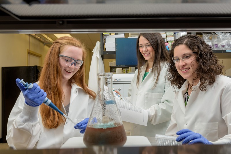 UD Engineering Prof. Emily Day (center) works in the laboratory with students Maggie Billingsley and Rachel Riley.