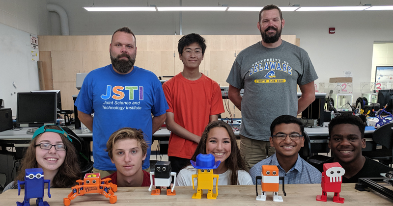 students with robots