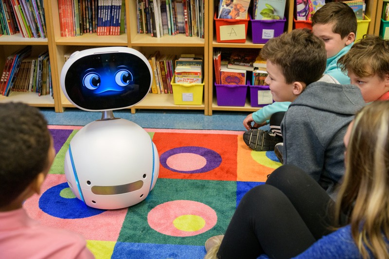 Fifth graders at The College School, located on UD's Newark Campus, watch Zenbo the social robot describe good habits for using technology.