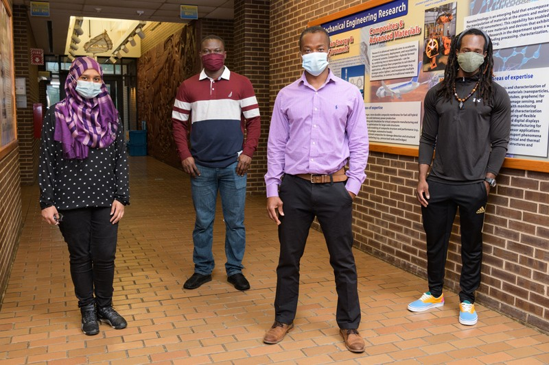 Prof. Koffi Pierre Yao (second from right) will spend three years working with three doctoral students from UD's Department of Mechanical Engineering on the development of a new lithium ion battery. The students are (from left to right) Rownak Jahan Mou, Gbenga Taiwo and Shane Nicholas Shearman.