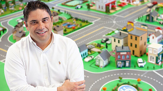 Andreas Malikopoulos in front of mini city
